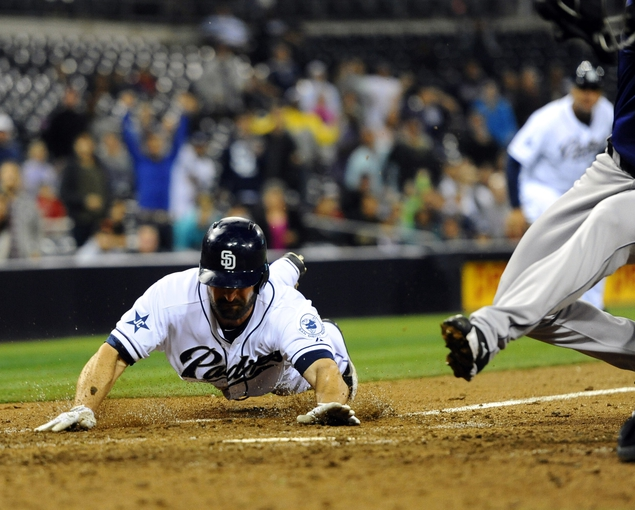 Apr 14, 2014; San Diego, CA, USA; San Diego Padres pinch hitter Xavier Nady (21) scores on a wild pitch to tie the game during the eighth inning against the Colorado Rockies at Petco Park. Mandatory Credit: Christopher Hanewinckel-USA TODAY Sports