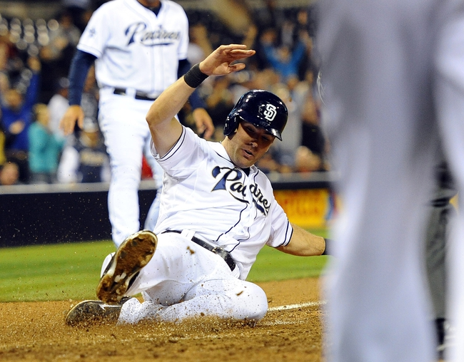 Apr 14, 2014; San Diego, CA, USA; San Diego Padres left fielder Seth Smith (12) scores the go-ahead run during the eighth inning against the Colorado Rockies at Petco Park. Mandatory Credit: Christopher Hanewinckel-USA TODAY Sports