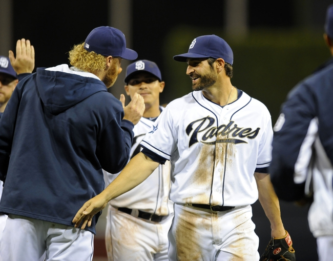 Apr 14, 2014; San Diego, CA, USA; San Diego Padres Xavier Nady (21) celebrates with teammates after a win against the Colorado Rockies at Petco Park. The Padres won 5-4. Mandatory Credit: Christopher Hanewinckel-USA TODAY Sports