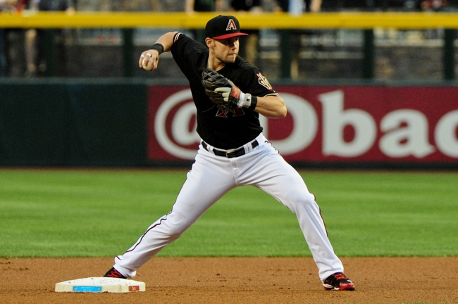 Apr 15, 2014; Phoenix, AZ, USA; Arizona Diamondbacks shortstop Chris Owings  throws to first base during the first inning against the New York Mets at Chase Field. Mandatory Credit: Matt Kartozian-USA TODAY Sports