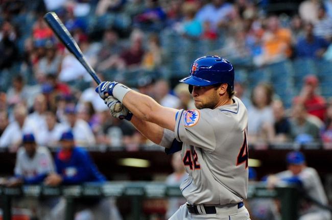 Apr 15, 2014; Phoenix, AZ, USA; New York Mets center fielder Kirk Nieuwenhuis hits a single during the first inning against the Arizona Diamondbacks at Chase Field. Mandatory Credit: Matt Kartozian-USA TODAY Sports