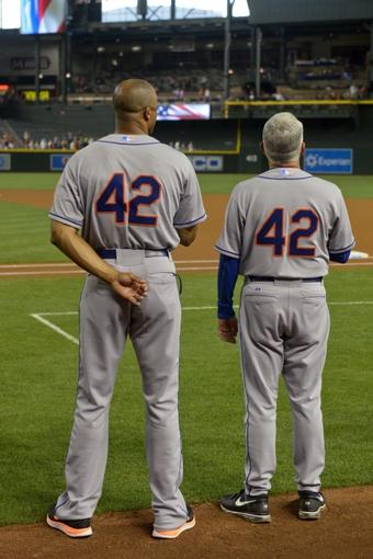 Apr 15, 2014; Phoenix, AZ, USA; All members of the New York Mets and Arizona Diamondbacks wear 42 for Jackie Robinson day at Chase Field. Mandatory Credit: Matt Kartozian-USA TODAY Sports
