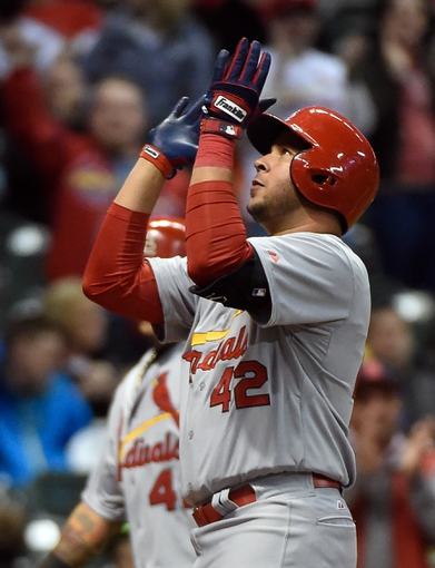 Apr 15, 2014; Milwaukee, WI, USA; St. Louis Cardinals shortstop Jhonny Peralta reacts after touching home plate following his 2-run home run in the ninth inning against the Milwaukee Brewers at Miller Park. The Cardinals beat the Brewers 6-1.  Mandatory Credit: Benny Sieu-USA TODAY Sports