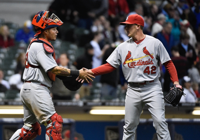 Apr 15, 2014; Milwaukee, WI, USA;  St. Louis Cardinals catcher Yadier Molina (left) congratulates pitcher Seth Maness (right) after the Cardinals beat the Milwaukee Brewers 6-1 at Miller Park. Mandatory Credit: Benny Sieu-USA TODAY Sports