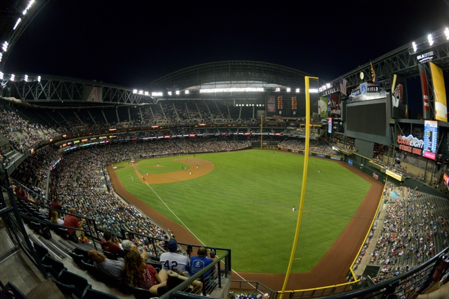 Apr 15, 2014; Phoenix, AZ, USA; General view of the game between the Arizona Diamondbacks and the New York Mets during the fourth inning at Chase Field. Mandatory Credit: Matt Kartozian-USA TODAY Sports