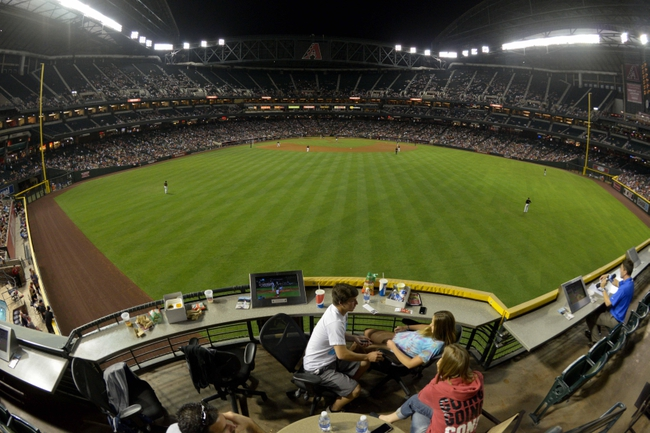 Apr 15, 2014; Phoenix, AZ, USA; Fans in center field ignore the game between the Arizona Diamondbacks and the New York Mets during the sixth inning at Chase Field. Mandatory Credit: Matt Kartozian-USA TODAY Sports