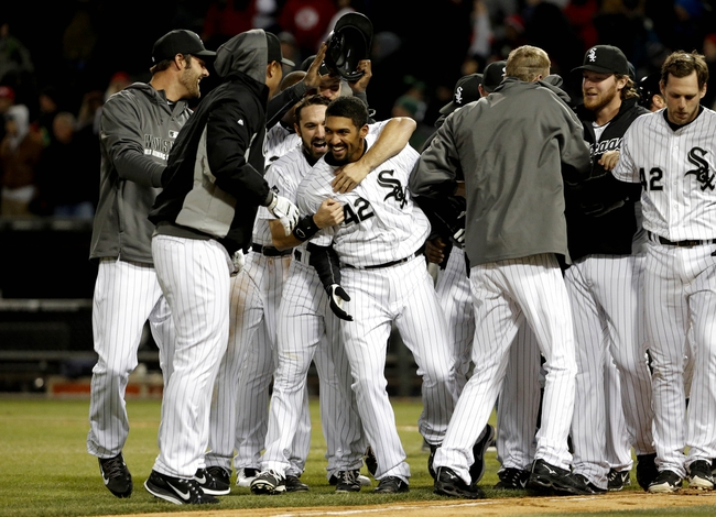 Apr 15, 2014; Chicago, IL, USA; Chicago White Sox infielder Marcus Simien (center) celebrates with the team after defeating the Boston Red Sox at U.S Cellular Field. The Chicago White Sox won 2-1. Mandatory Credit: Jon Durr-USA TODAY Sports