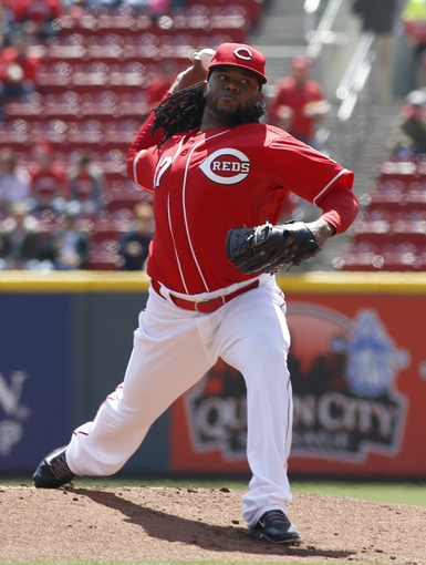 Apr 16, 2014; Cincinnati, OH, USA; Cincinnati Reds starting pitcher Johnny Cueto throws against the Pittsburgh Pirates during the first inning at Great American Ball Park. Mandatory Credit: David Kohl-USA TODAY Sports