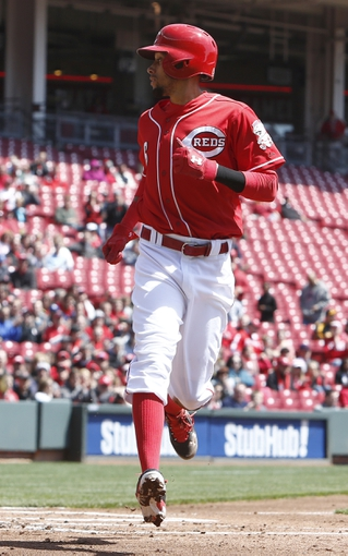 Apr 16, 2014; Cincinnati, OH, USA; Cincinnati Reds center fielder Billy Hamilton (6) scores at home after a wild pitch from Pittsburgh Pirates starting pitcher Francisco Liriano during the first inning at Great American Ball Park. Mandatory Credit: David Kohl-USA TODAY Sports