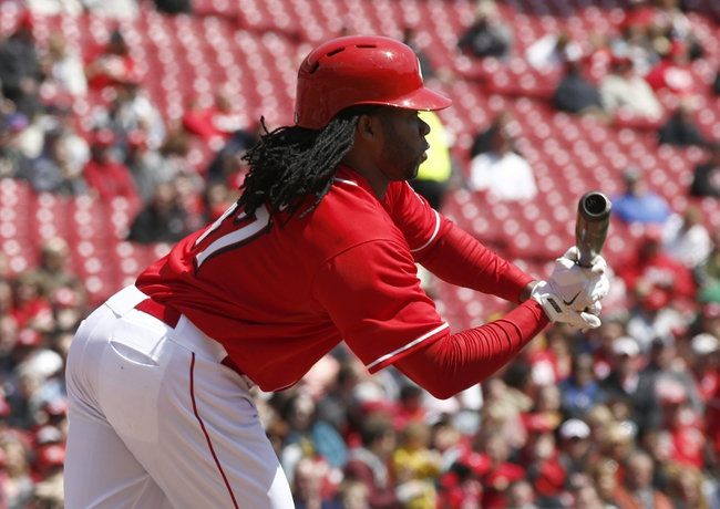 Apr 16, 2014; Cincinnati, OH, USA; Cincinnati Reds starting pitcher Johnny Cueto bunts during the second inning during a game against the Pittsburgh Pirates at Great American Ball Park. Mandatory Credit: David Kohl-USA TODAY Sports