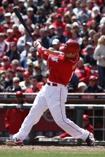 Apr 16, 2014; Cincinnati, OH, USA; Cincinnati Reds first baseman Joey Votto hits a two-run home run off Pittsburgh Pirates starting pitcher Francisco Liriano during the seventh inning at Great American Ball Park. The Reds won 4-0. Mandatory Credit: David Kohl-USA TODAY Sports