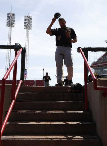 Apr 16, 2014; Cincinnati, OH, USA; Pittsburgh Pirates first baseman Gaby Sanchez (17) walks off the field at the end of the seventh inning during a game against the Cincinnati Reds at Great American Ball Park. The Reds won 4-0. Mandatory Credit: David Kohl-USA TODAY Sports
