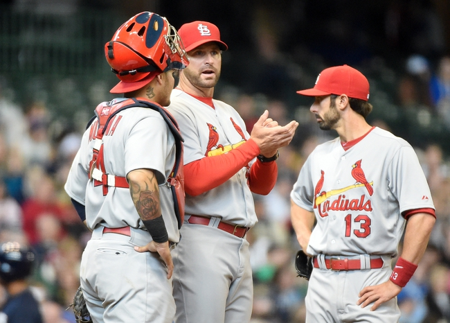 Apr 16, 2014; Milwaukee, WI, USA;   St. Louis Cardinals manager Mike Matheny (center) makes a pitching change in the eighth inning during the game against the Milwaukee Brewers at Miller Park. Mandatory Credit: Benny Sieu-USA TODAY Sports