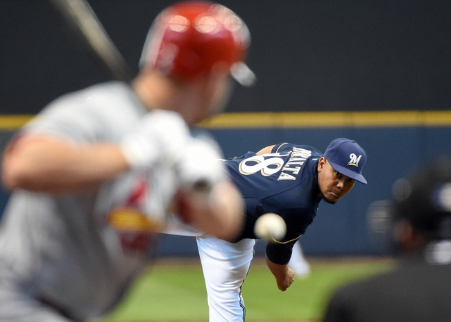 Apr 16, 2014; Milwaukee, WI, USA;   Milwaukee Brewers pitcher Wily Peralta (38) pitches in the first inning against the St. Louis Cardinals at Miller Park. Peralta pitched six plus inning giving up one run on six hits as the Brewers beat the Cardinals 5-1.   Mandatory Credit: Benny Sieu-USA TODAY Sports
