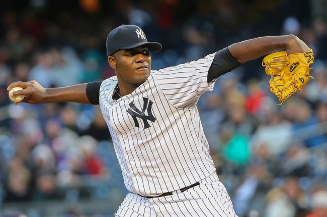 Apr 16, 2014; Bronx, NY, USA;  New York Yankees starting pitcher Michael Pineda (35) delivers a pitch during the first inning against the Chicago Cubs at Yankee Stadium. Mandatory Credit: Anthony Gruppuso-USA TODAY Sports