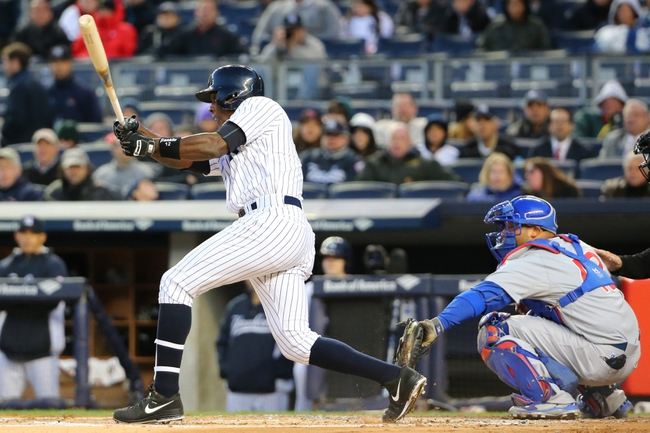Apr 16, 2014; Bronx, NY, USA;  New York Yankees designated hitter Alfonso Soriano (12) reaches on an infield single advancing a man during the first inning against the Chicago Cubs at Yankee Stadium. Mandatory Credit: Anthony Gruppuso-USA TODAY Sports