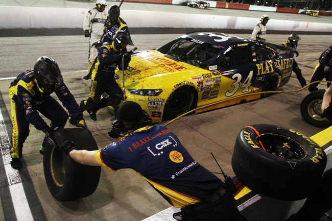 Apr 12, 2014; Darlington, SC, USA; NASCAR Sprint Cup driver David Ragan (34) makes a put stop during the Southern 500 at Darlington Raceway. Mandatory Credit: Peter Casey-USA TODAY Sports