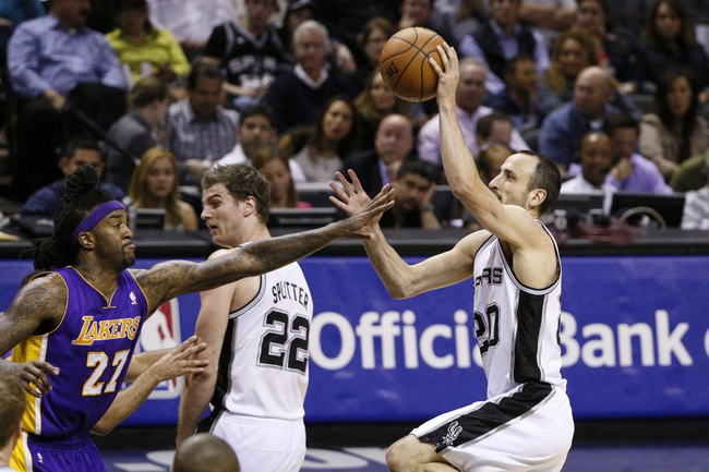 Apr 16, 2014; San Antonio, TX, USA; San Antonio Spurs guard Manu Ginobili (20) shoots the ball over Los Angeles Lakers forward Jordan Hill (27) during the first half at AT&T Center. Mandatory Credit: Soobum Im-USA TODAY Sports