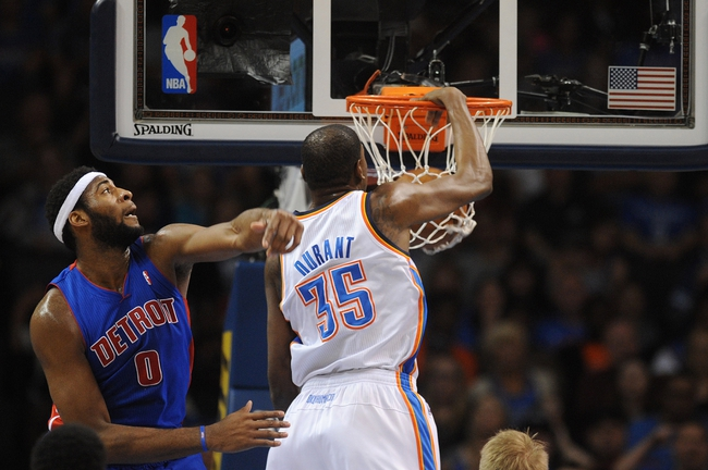 Apr 16, 2014; Oklahoma City, OK, USA;  Oklahoma City Thunder forward Kevin Durant (35) dunks the ball against Detroit Pistons center Andre Drummond (0) during the second quarter at Chesapeake Energy Arena. Mandatory Credit: Mark D. Smith-USA TODAY Sports