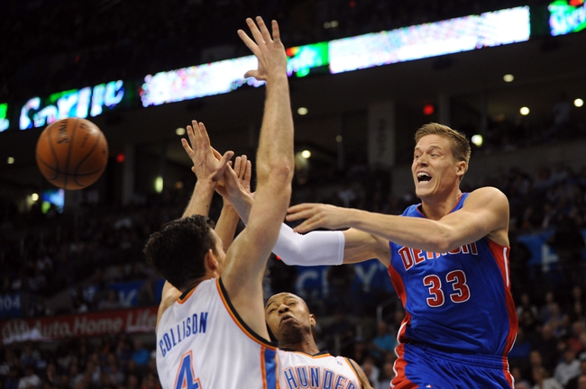 Apr 16, 2014; Oklahoma City, OK, USA;  Detroit Pistons forward Jonas Jerebko (33) passes the ball against Oklahoma City Thunder forward Nick Collison (4) and Oklahoma City Thunder forward Caron Butler (2) during the second quarter at Chesapeake Energy Arena. Mandatory Credit: Mark D. Smith-USA TODAY Sports