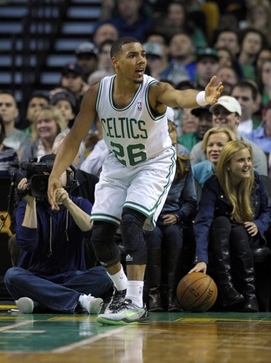 Apr 16, 2014; Boston, MA, USA; Boston Celtics guard Phil Pressey (26) reacts after losing the ball out of bounds during the first half against the Washington Wizards at TD Garden. Mandatory Credit: Bob DeChiara-USA TODAY Sports