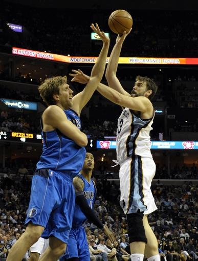 Apr 16, 2014; Memphis, TN, USA; Memphis Grizzlies center Marc Gasol (33) shoots over Dallas Mavericks forward Dirk Nowitzki (41) during the game at FedExForum. Mandatory Credit: Justin Ford-USA TODAY Sports