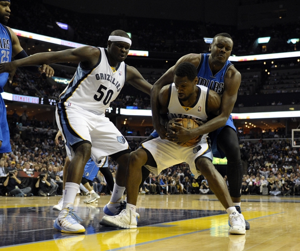 Apr 16, 2014; Memphis, TN, USA; Memphis Grizzlies guard Tony Allen (9) and Dallas Mavericks center DeJuan Blair (45) fight for the ball during the game at FedExForum. Mandatory Credit: Justin Ford-USA TODAY Sports