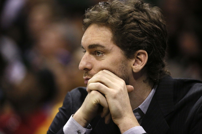 Apr 16, 2014; San Antonio, TX, USA; Los Angeles Lakers center Pau Gasol (16) watches from the bench during the second half against the San Antonio Spurs at AT&T Center. Mandatory Credit: Soobum Im-USA TODAY Sports