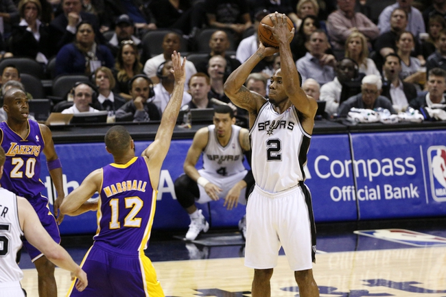 Apr 16, 2014; San Antonio, TX, USA; San Antonio Spurs forward Kawhi Leonard (2) shoots the ball over Los Angeles Lakers guard Kendall Marshall (12) during the first half at AT&T Center. Mandatory Credit: Soobum Im-USA TODAY Sports