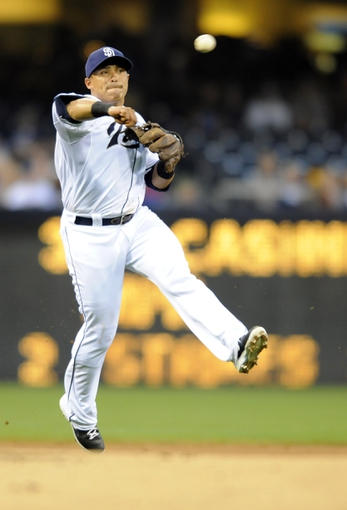 Apr 16, 2014; San Diego, CA, USA; San Diego Padres shortstop Everth Cabrera (2) throws to first base for an out during the first inning against the Colorado Rockies at Petco Park. Mandatory Credit: Christopher Hanewinckel-USA TODAY Sports