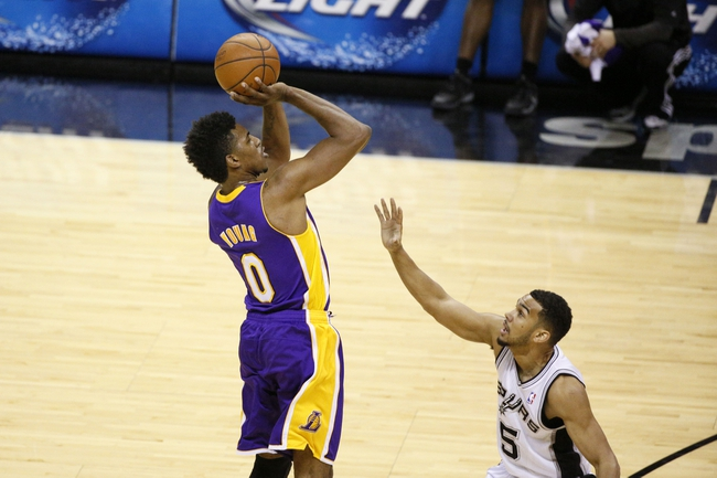 Apr 16, 2014; San Antonio, TX, USA; Los Angeles Lakers forward Nick Young (0) shoots the ball over San Antonio Spurs guard Cory Joseph (5) during the first half at AT&T Center. Mandatory Credit: Soobum Im-USA TODAY Sports