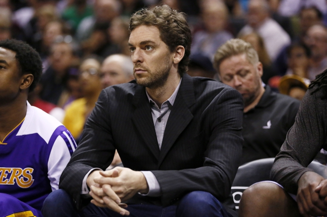 Apr 16, 2014; San Antonio, TX, USA; Los Angeles Lakers center Pau Gasol (16) watches from the bench against the San Antonio Spurs during the second half at AT&T Center. The Lakers won 113-100. Mandatory Credit: Soobum Im-USA TODAY Sports