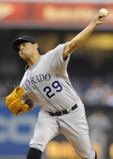 Apr 16, 2014; San Diego, CA, USA; Colorado Rockies starting pitcher Jorge De La Rosa (29) throws during the first inning against the San Diego Padres at Petco Park. Mandatory Credit: Christopher Hanewinckel-USA TODAY Sports