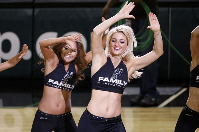 Apr 16, 2014; San Antonio, TX, USA; San Antonio Spurs cheerleaders perform during the first half against the Los Angeles Lakers at AT&T Center. Mandatory Credit: Soobum Im-USA TODAY Sports