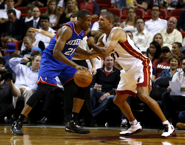 Apr 16, 2014; Miami, FL, USA; Philadelphia 76ers forward Thaddeus Young dribbles the ball as Miami Heat forward Shane Battier (31) defends in the second half at American Airlines Arena. The 76ers won 100-87. Mandatory Credit: Robert Mayer-USA TODAY Sports