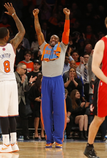 Apr 16, 2014; New York, NY, USA;  New York Knicks forward Amar'e Stoudemire (1) celebrates victory over Toronto Raptors at Madison Square Garden. New York Knicks defeat the Toronto Raptors 95-92. Mandatory Credit: Jim O'Connor-USA TODAY Sports