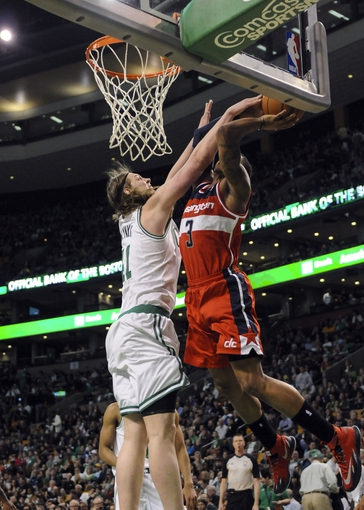Apr 16, 2014; Boston, MA, USA; Boston Celtics center Kelly Olynyk (41) fouls Washington Wizards guard Bradley Beal (3) during the second half at TD Garden. Mandatory Credit: Bob DeChiara-USA TODAY Sports