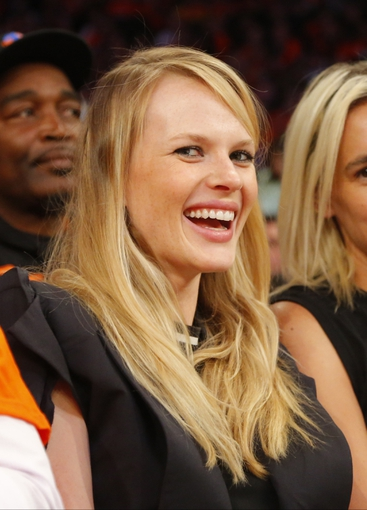 Apr 16, 2014; New York, NY, USA;  Anne Vyalitsyna sits court side during game between the New York Knicks and the Toronto Raptors at Madison Square Garden. New York Knicks defeat the Toronto Raptors 95-92. Mandatory Credit: Jim O'Connor-USA TODAY Sports