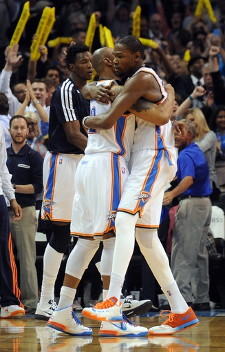 Apr 16, 2014; Oklahoma City, OK, USA;  Oklahoma City Thunder forward Caron Butler (2) hugs Oklahoma City Thunder forward Kevin Durant (35) after defeating the Detroit Pistons to clinch the number 2 seed in the playoffs at Chesapeake Energy Arena. The Thunder defeated the Pistons by a score of 112-111. Mandatory Credit: Mark D. Smith-USA TODAY Sports