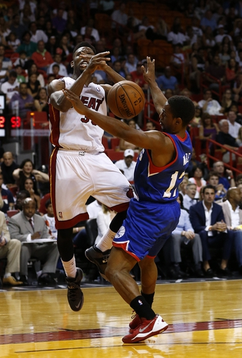 Apr 16, 2014; Miami, FL, USA;  Miami Heat guard Norris Cole (30) is called for a charge against Philadelphia 76ers guard Casper Ware (17) in the second half at American Airlines Arena. The 76ers won 100-87. Mandatory Credit: Robert Mayer-USA TODAY Sports