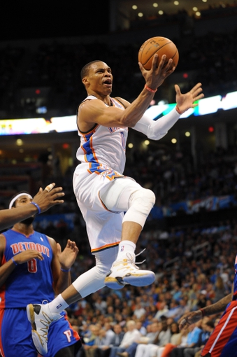 Apr 16, 2014; Oklahoma City, OK, USA;  Oklahoma City Thunder guard Russell Westbrook (0) drives to the basket against Detroit Pistons center Andre Drummond (0) during the third quarter at Chesapeake Energy Arena. Mandatory Credit: Mark D. Smith-USA TODAY Sports