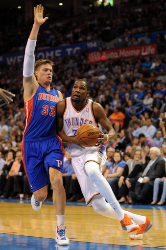 Apr 16, 2014; Oklahoma City, OK, USA;  Oklahoma City Thunder forward Kevin Durant (35) drives to the basket against Detroit Pistons forward Jonas Jerebko (33) during the fourth quarter at Chesapeake Energy Arena. Mandatory Credit: Mark D. Smith-USA TODAY Sports