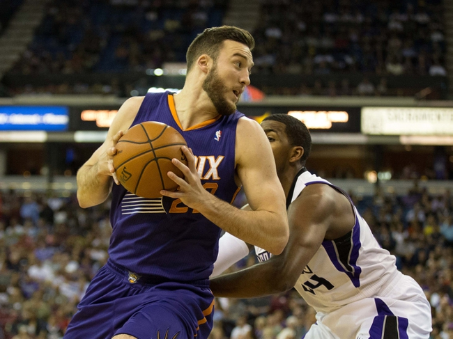 Apr 16, 2014; Sacramento, CA, USA; Phoenix Suns center Miles Plumlee (22) drives in against Sacramento Kings forward Jason Thompson (34) during the first quarter at Sleep Train Arena. Mandatory Credit: Kelley L Cox-USA TODAY Sports