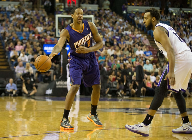 Apr 16, 2014; Sacramento, CA, USA; Phoenix Suns forward Channing Frye (8) passes the ball against Sacramento Kings forward Derrick Williams (13) during the first quarter at Sleep Train Arena. Mandatory Credit: Kelley L Cox-USA TODAY Sports