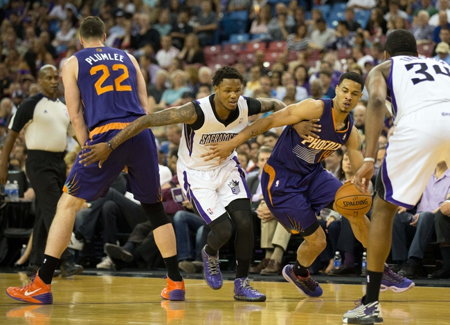Apr 16, 2014; Sacramento, CA, USA; Phoenix Suns guard Gerald Green (14) drives in against Sacramento Kings guard Ben McLemore (16) with a screen by Phoenix Suns center Miles Plumlee (22) during the first quarter at Sleep Train Arena. Mandatory Credit: Kelley L Cox-USA TODAY Sports