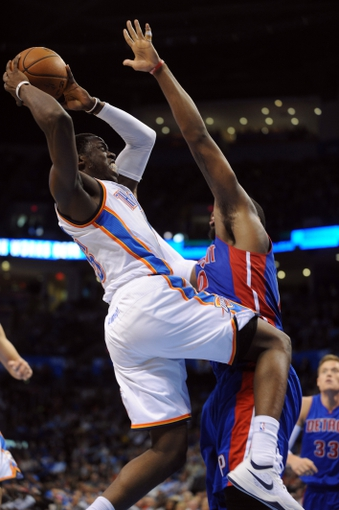 Apr 16, 2014; Oklahoma City, OK, USA;  Oklahoma City Thunder guard Reggie Jackson (15) attempts a shot against Detroit Pistons center Andre Drummond (0) during the third quarter at Chesapeake Energy Arena. Mandatory Credit: Mark D. Smith-USA TODAY Sports
