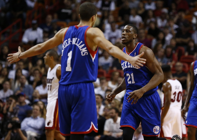 Apr 16, 2014; Miami, FL, USA; Philadelphia 76ers guard Michael Carter-Williams (1) reacts after a basket by forward Thaddeus Young (21) in the second half of a game against the Miami Heat at American Airlines Arena. The 76ers won 100-87. Mandatory Credit: Robert Mayer-USA TODAY Sports
