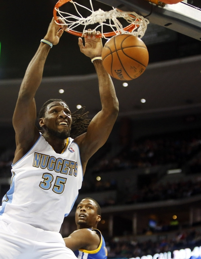 Apr 16, 2014; Denver, CO, USA; Denver Nuggets forward Kenneth Faried (35) dunks the ball during the first quarter against the Golden State Warriors at Pepsi Center. Mandatory Credit: Chris Humphreys-USA TODAY Sports