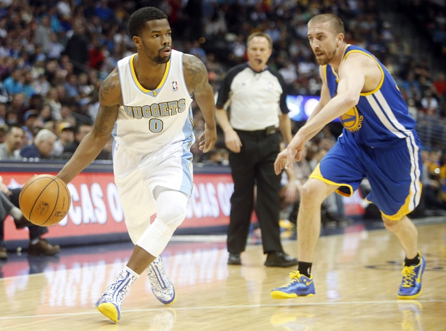 Apr 16, 2014; Denver, CO, USA; Denver Nuggets guard Aaron Brooks (0) drives to the basket during the first quarter against the Golden State Warriors at Pepsi Center. Mandatory Credit: Chris Humphreys-USA TODAY Sports