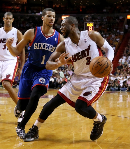 Apr 16, 2014; Miami, FL, USA; Miami Heat guard Dwyane Wade (3) is defended by Philadelphia 76ers guard Michael Carter-Williams (1) in the second half at American Airlines Arena. The 76ers won 100-87. Mandatory Credit: Robert Mayer-USA TODAY Sports